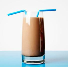 Glass of Chocolate Milk with Two Straws